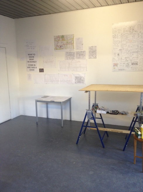 My drawing table and a display of research sketches, interviews and artefacts.